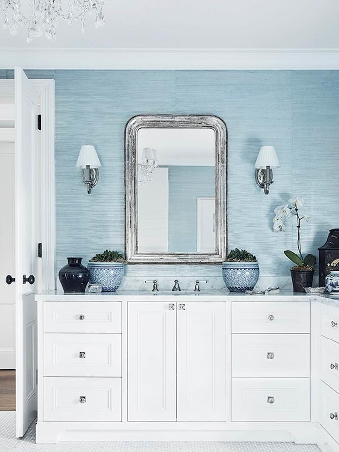 """Designer Lynda Kerry says """"One of the briefs was to relocate the sweeping staircase and replace it with a spacious master bedroom overlooking Sydney Harbour with separate 'his and hers' ensuites and wardrobes. This is 'her' ensuite, with an ethereal palette that is sympathetic to the tones of the bedroom. Marble enhances this luxurious and ethereal bathroom. The wallpaper and fabrics reflect the calm colours of the sea and sky."""" From *Belle* November 2018."""