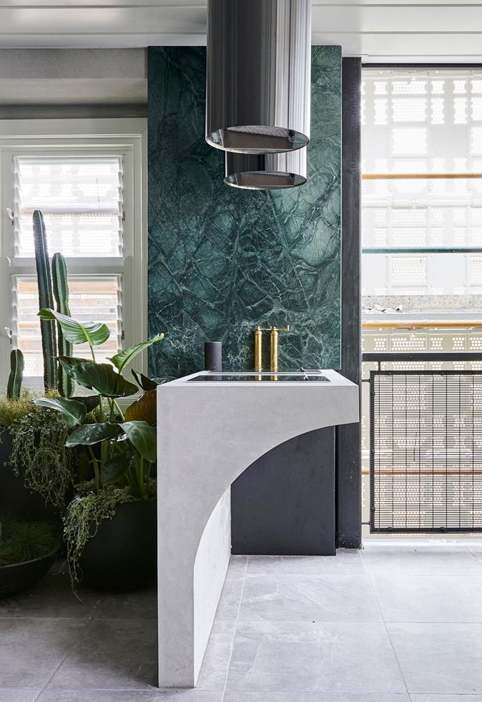 "In the design of their apartment's [terrace and outdoor room](https://www.homestolove.com.au/the-block-2018-terrace-and-outdoor-rooms-19116|target=""_blank""), Hayden and Sara opted for a chic concrete built-in outdoor barbecue paired with striking green marble."