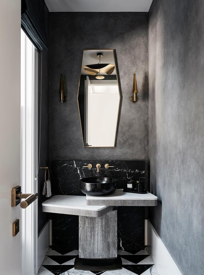 Custom marble vanity in the powder room by Dylan Farrell Design. Light fittings and mirror from 1stdibs. Square marble floor tiles were cut on the diagonal to provide a play on shapes.