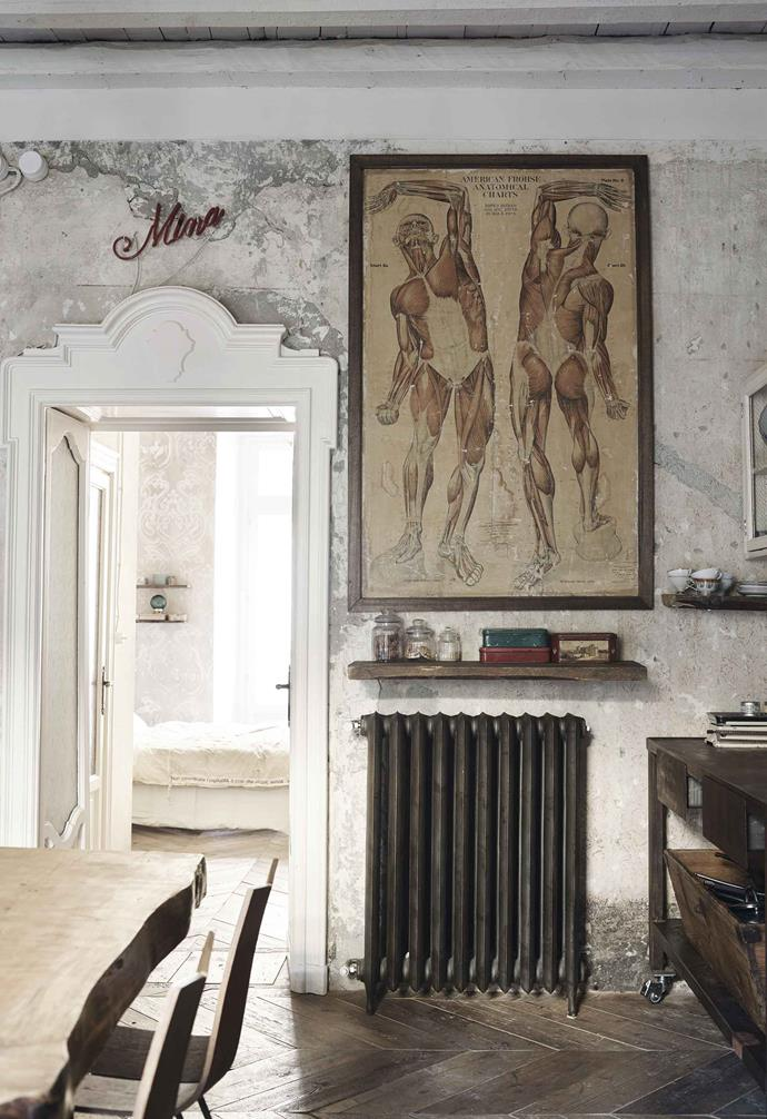 **Living room** An old anatomical print reinforces the pared-back feel. The radiator is secondhand and the floor is reclaimed timber, found on a demolition site and arranged in a parquetry pattern.