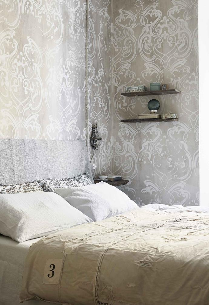 **Main bedroom** The walls were hand-stamped by Gouache, a local wall-art company, using a motif Anna designed. Bed cover by Draga & Aurel.