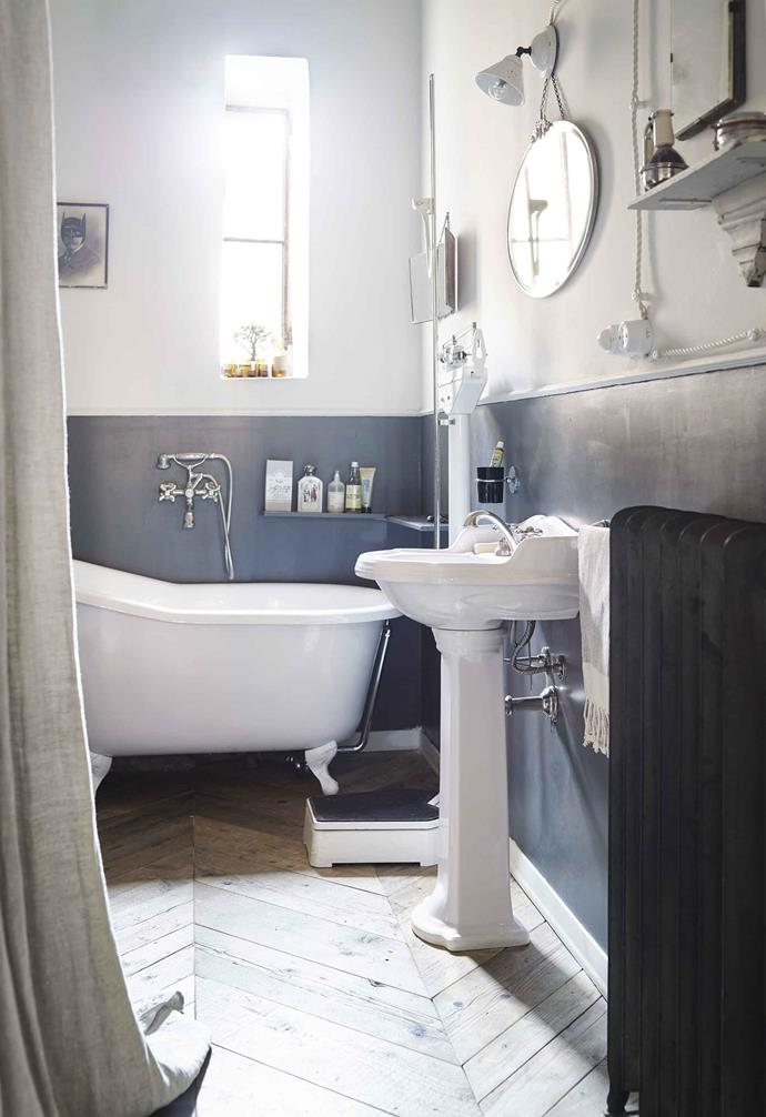 **Bathroom** The timber floorboards continue in here, where modern convenience is camouflaged by industrial metal accessories. Bath from Cargo Milano and pedestal basin by Simas.