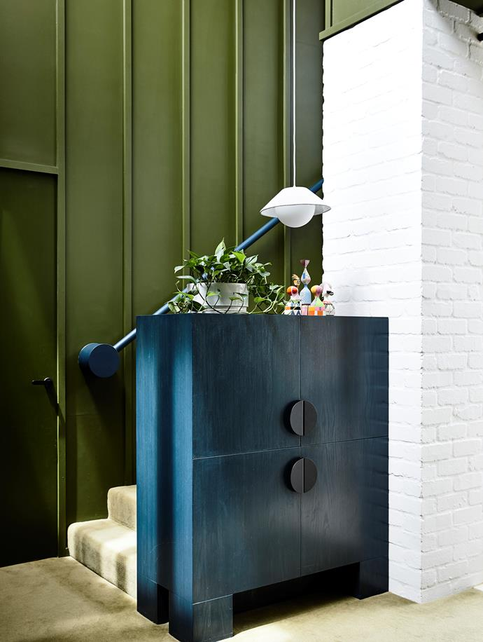 Circle details on the balustrade and cabinet reinforce the graphic 'voice' of the extension. Alexander Girard dolls from Space. Bespoke cabinet. Akoya pendant light, Living Edge.