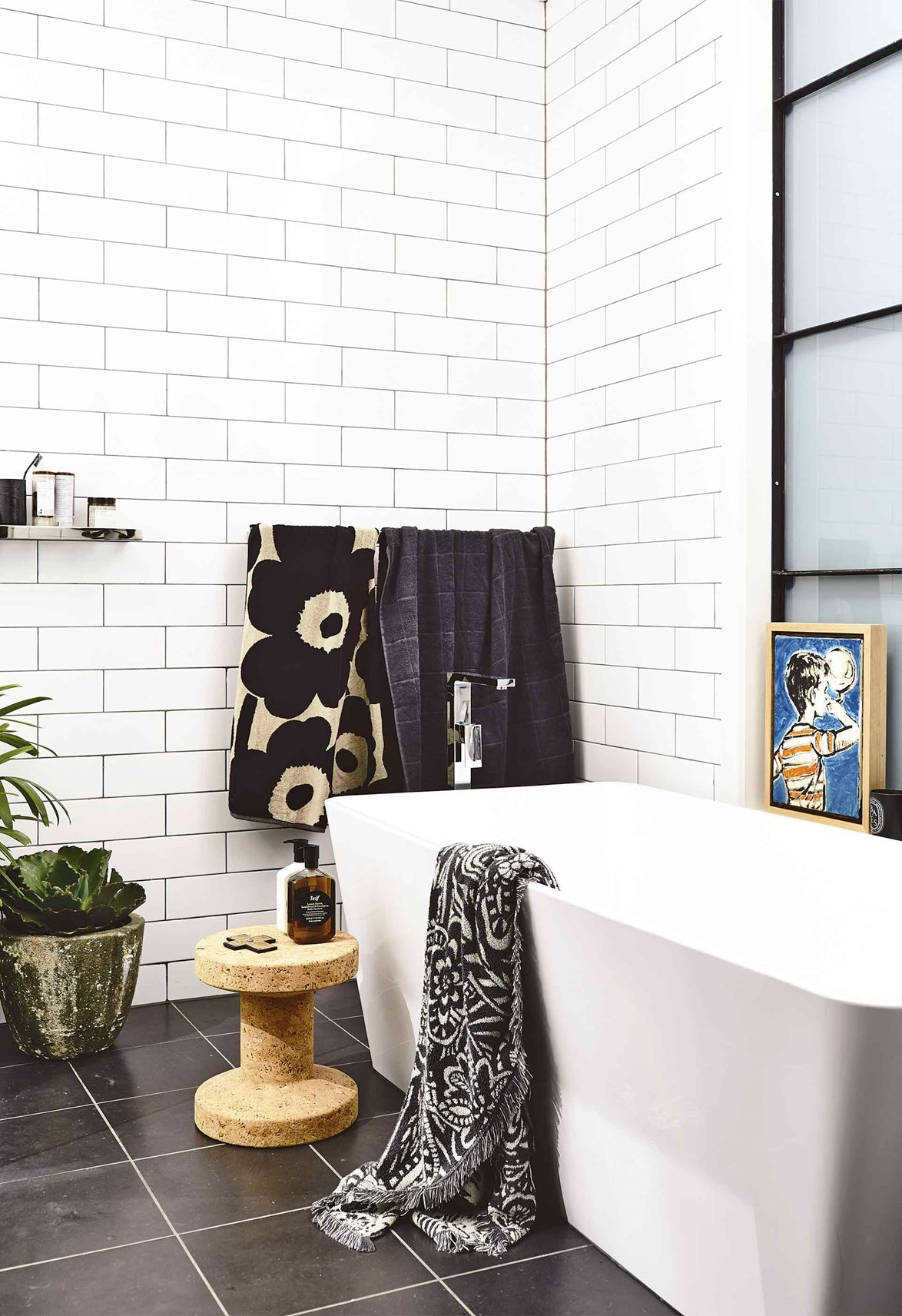 Decorative touches like, indoor plants, good-quality towels and artwork, will help to make a bathroom feel warm and inviting.