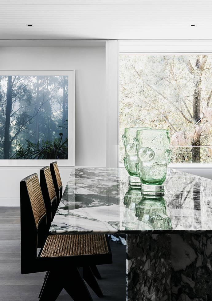 Artwork by Felix Forest. Custom dining table by Handelsmann + Khaw in marble from Granite & Marble Works with Pierre Jeanneret dining chairs from Phantom Hands. Murano vases from The Vault.