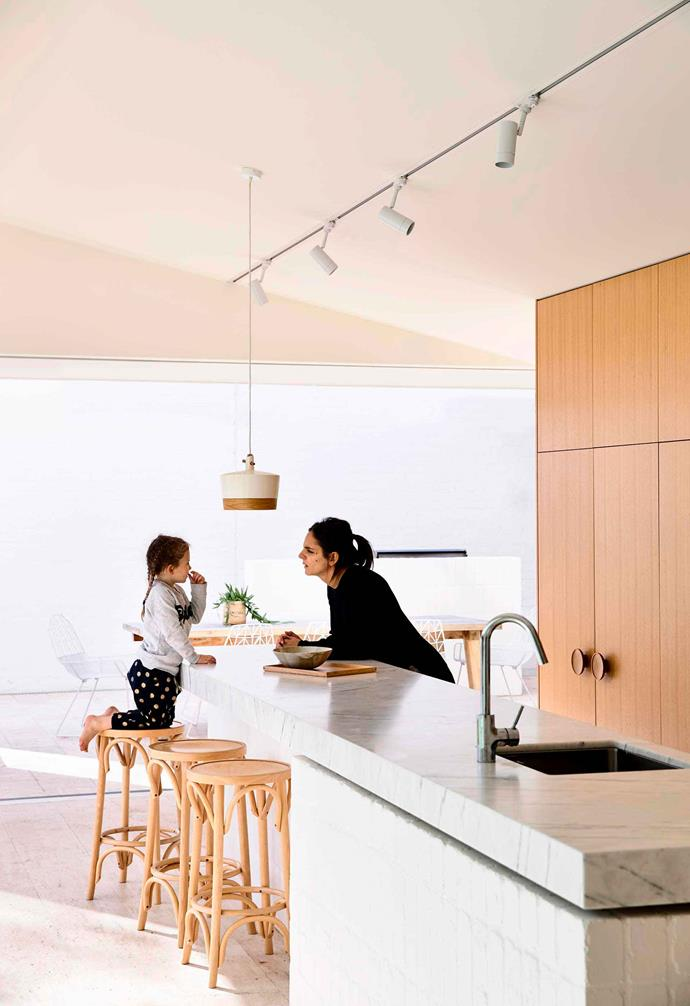 "In the new extension of this [modernist-inspired red brick home](https://www.homestolove.com.au/modernist-red-brick-home-17821|target=""_blank"") painted white bricks have become a central design feature. Extending into the kitchen, the [kitchen island](https://www.homestolove.com.au/kitchen-inspiration-13-of-the-best-island-benches-17943