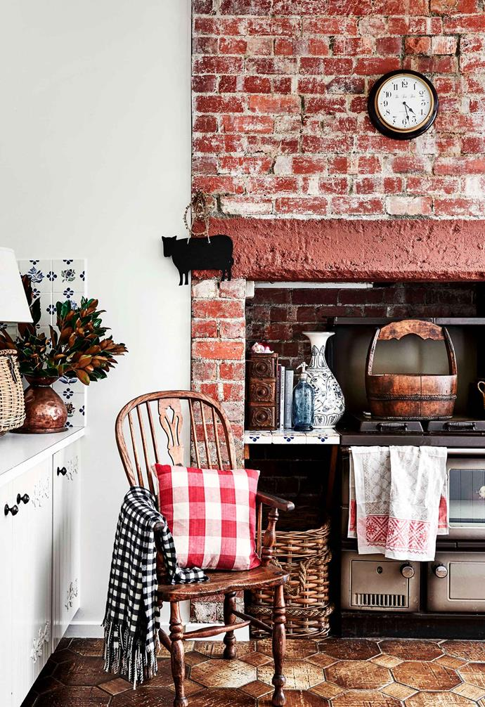 "The rustic look of this kitchen space is enhanced by the original red bricks that house the main cooking station in this [Tudor-style homestead](https://www.homestolove.com.au/tudor-style-homestead-australia-20109|target=""_blank""). Weathered neutral-toned hexagon tiles add a playful contrast."