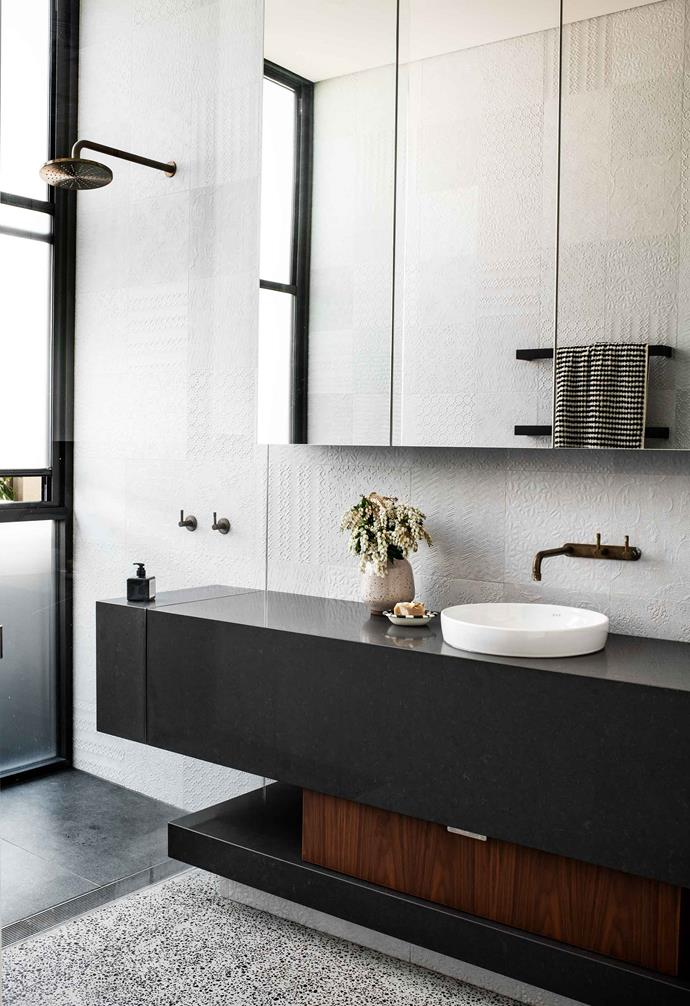 """**Bathroom** The vanity unit mirrors the home's overall look. Towels, [Miss April](https://www.missapril.com.au/ target=""""_blank"""" rel=""""nofollow""""). Vase and handwash, [chalk on stone](https://www.instagram.com/chalkonstone/ target=""""_blank"""" rel=""""nofollow"""")."""