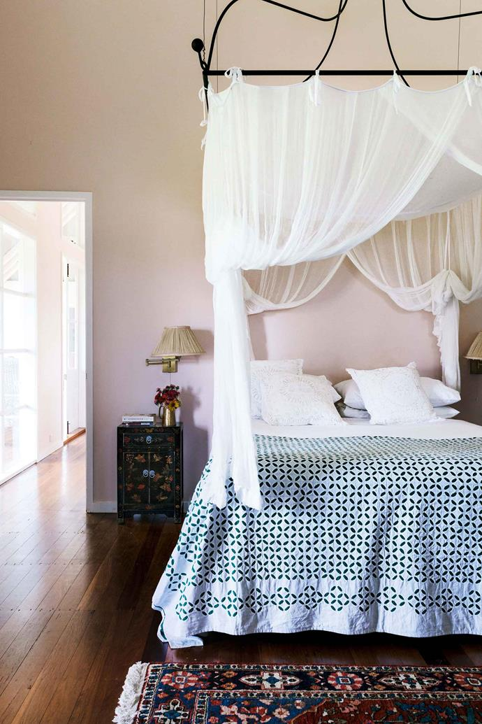 The bed canopy in Sandra and Andy's bedroom was made by Hans Welding Works in Ipswich and designed by Mary Durack. The bedspread was bought during travels in Mumbai.
