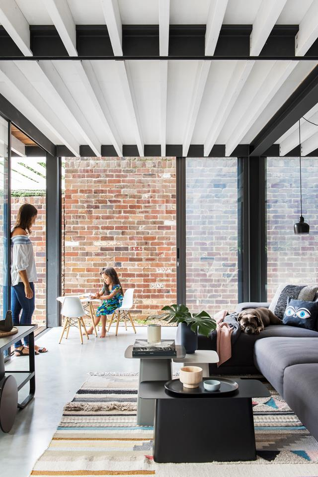 "Steel-framed doors add to the [European warehouse feel](https://www.homestolove.com.au/a-new-build-with-warehouse-feel-in-sydneys-inner-west-6921|target=""_blank"") of this family home and open up the living room to the outdoors."