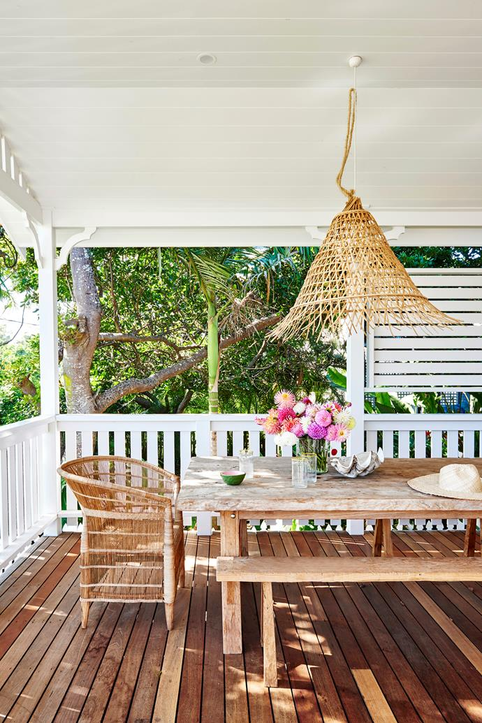 """""""I'd admired this house with its beautiful big front deck for years while holidaying in Byron,"""" Zoe tells. """"When it came up for sale, we pounced!"""" She furnished the outdoor space with a table and benches custom-made in Bali, Malawi chairs from Greedilulu and a Bisque pendant."""