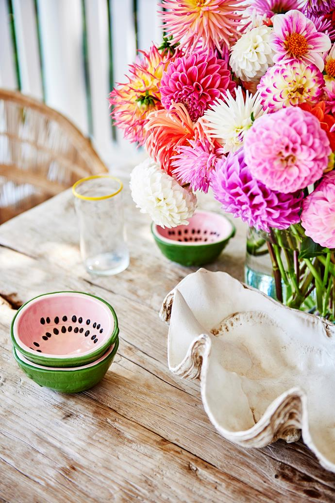 Countless family meals have been enjoyed on the front deck. Zoe found the vintage watermelon bowls at Nyary ES.
