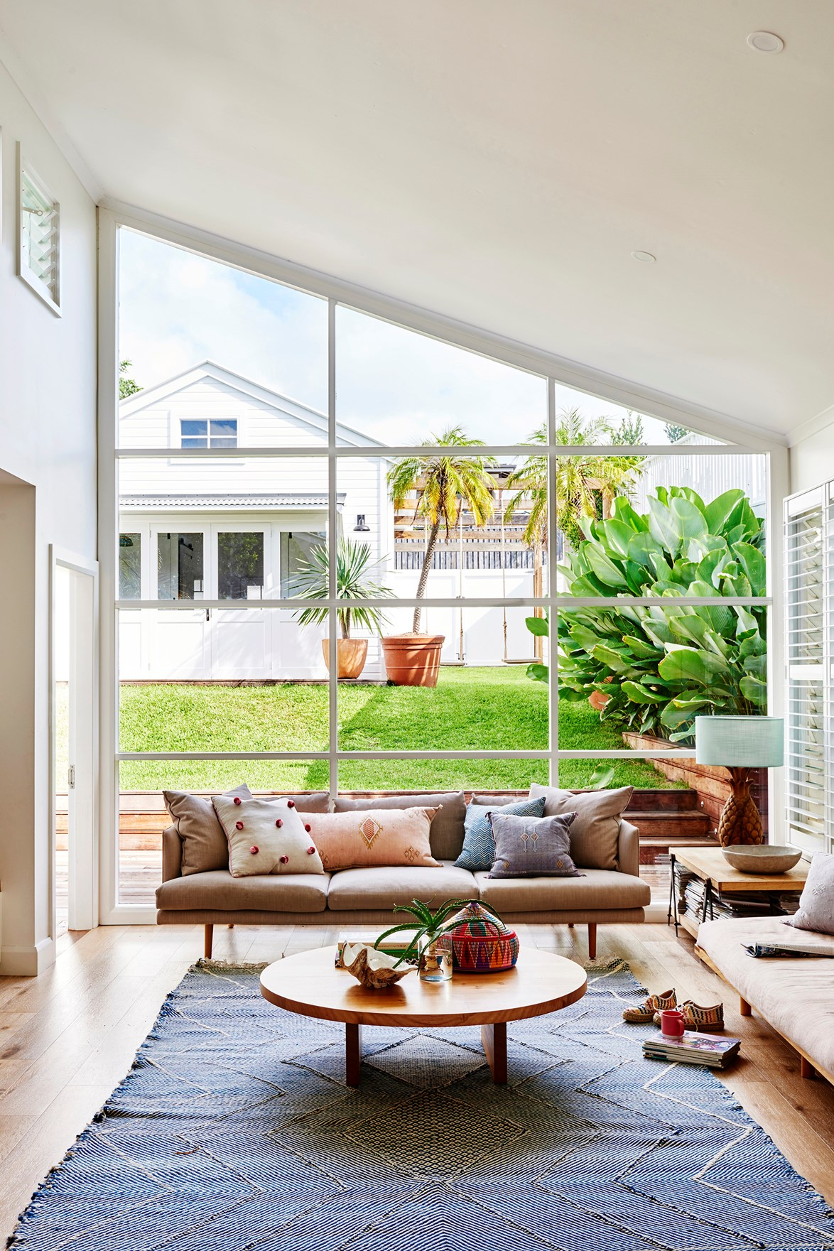 "A textured blue rug from Tigmi Trading adds colour and warmth to the breezy living room in this [Byron Bay home](https://www.homestolove.com.au/coastal-cottage-byron-bay-20442|target=""_blank"")."