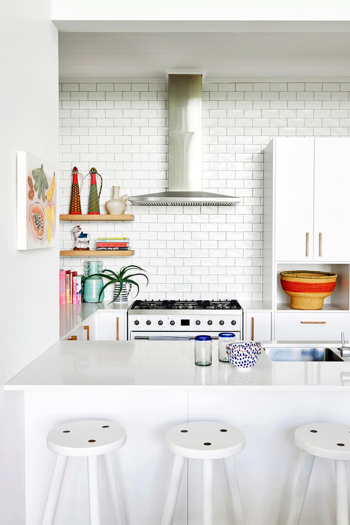 """""""I wanted an all-white kitchen that looked fresh and was easy to clean,"""" Zoe says. She chose a subway-tiled splashback, Caesarstone benchtops and stools from Market Import."""
