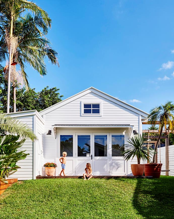 In their Byron Bay backyard, homeowners Zoe and Jimi Paul have created a lush landscaped grass area ideal for their three children and pet dog. An on-site studio is fitted out with a bedroom, bathroom and kitchenette.