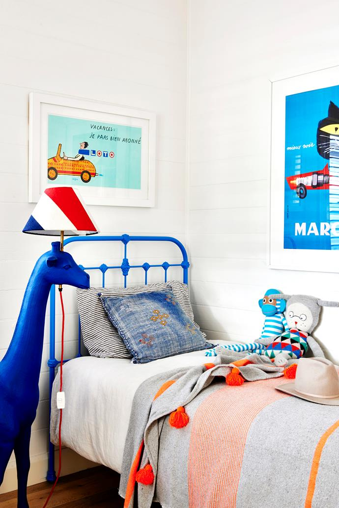 """Zoe went for a """"colourful, fun and not too childlike"""" look in Willy's bedroom. The custom-made bed came from Scout House, while the antique giraffe sculpture-cum-floor lamp was sourced from Nyary ES."""