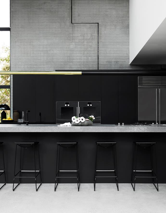 Kitchen in Polytec Venette finish by Freedom Kitchens. Sub-Zero refrigerator and Gaggenau appliances, all from Winning Appliances. Viccarbe 'Last Minute' stools from Hub. Custom pendant light in solid brass. Active Plus pull-out nozzle tap from Franke. Zip HydroTap in matt black. Caesarstone 'Rugged Concrete' engineered stone bench top.