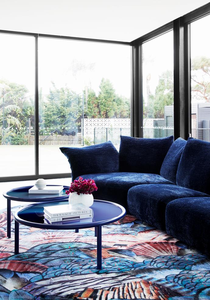 In the media room, Glas Italia 'LA Sunset' coffee table, Edra 'Absolu' sofa and Moooi 'Calligraphy Bird' rug, all from Space.