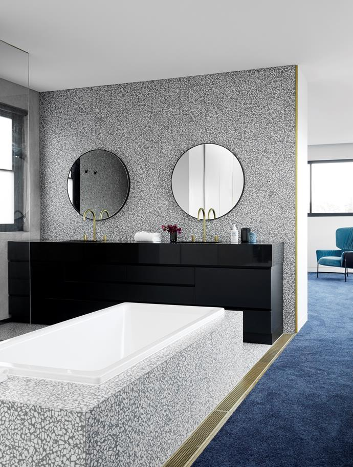 In the main ensuite, Kaldewei 'Puro' inset bath and Sussex 'Circa' basin tapware in Living Tumbled Brass, all from Reece. 'Flynn' mirrors from RJ Living. Artwork 'Basic 01' matt tiles in Glossy Green from Di Lorenzo. Carpet from Signature Floors.