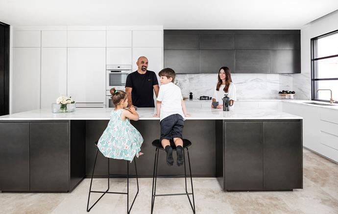 The modular kitchen is by Italian firm Arrital, which also provided much of the bespoke cabinetry for a cohesive look. Calacatta Oro marble splashback and benchtops, M&G Stone. Stools, Ultimo. Appliances, Miele.