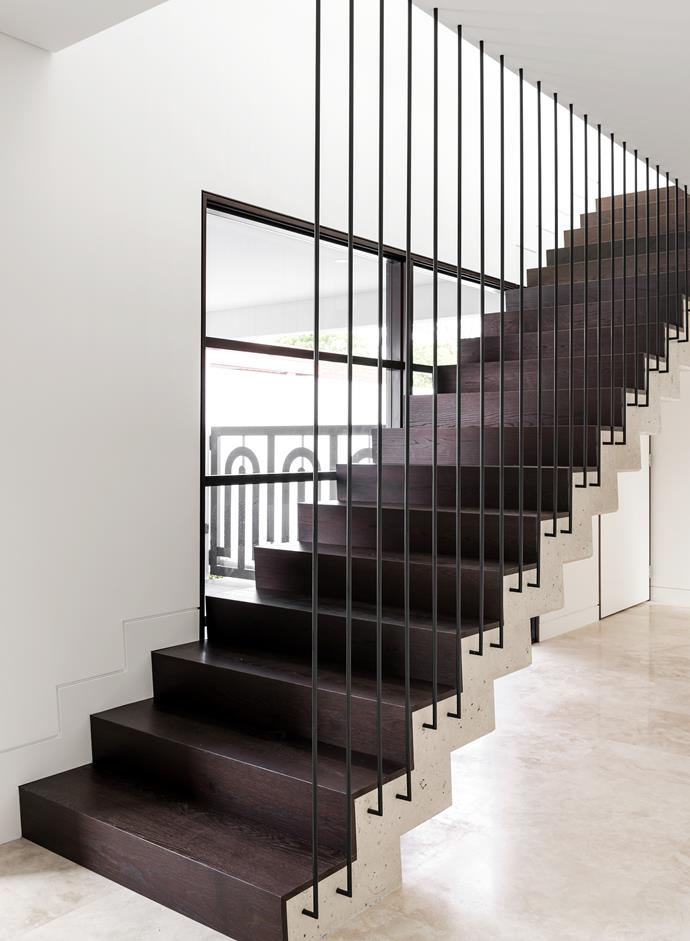 "The white-concrete stairs and steel balustrading were custom-designed by Bacic Group. ""They really ramp up the glamour,"" says Elvira. The treads are made from stained oak."
