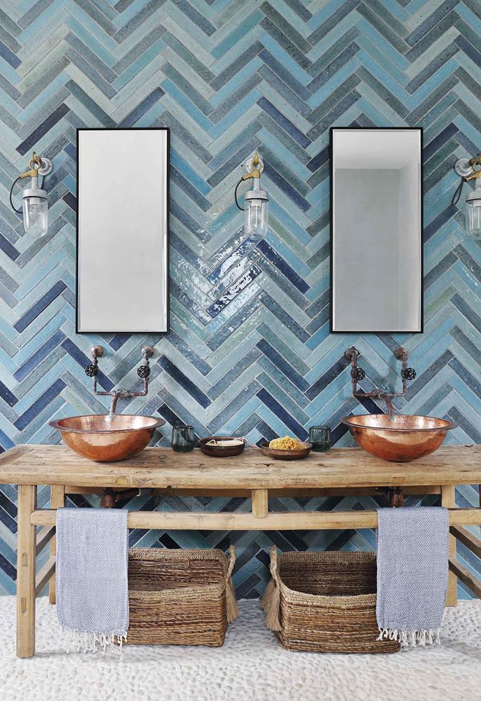 **Guest bathroom** Glazed ceramic tiles in a herringbone pattern set off the hammered-brass basins from Habibi Interiors. They perch on an antique Chinese console.