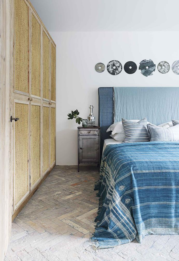"**Guest bedroom** Decorative stone discs add an industrial touch to go with the vintage side tables. Indigo cloth and Fermoie cushion fabrics, [HZI](http://www.hzinteriors.com/|target=""_blank""
