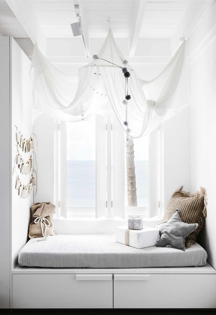 "A cosy window seat in this [all-white Mediterranean-style home](https://www.homestolove.com.au/mediterranean-style-all-white-home-16945|target=""_blank"") made the most of this bedroom nook, with clever storage built-in to the bench seat."