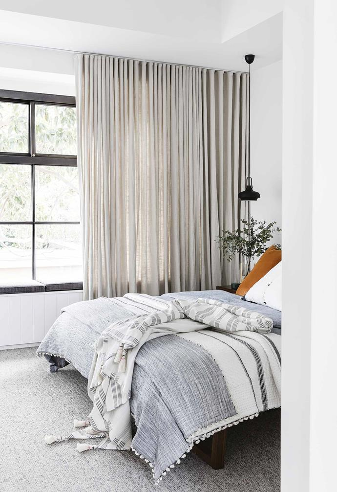 "Sheer curtains in the bedroom of this [renovated Federation cottage](https://www.homestolove.com.au/federation-cottage-queens-park-18311|target=""_blank"") can hide the window seat and block sunlight as needed."