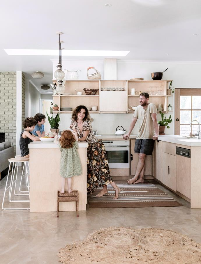 "Custom plywood cabinetry was a practical and affordable solution for this family-friendly [Byron Bay home](https://www.homestolove.com.au/a-1970s-byron-bay-bungalow-updated-with-hygge-style-6983|target=""_blank""). All the home's plywood cabinets, including those in the bathroom and laundry, feature the same handle cut-outs. ""Our kids are notorious for breaking handles off things, so this tackled that dilemma,"" homeowner Chloe explains."