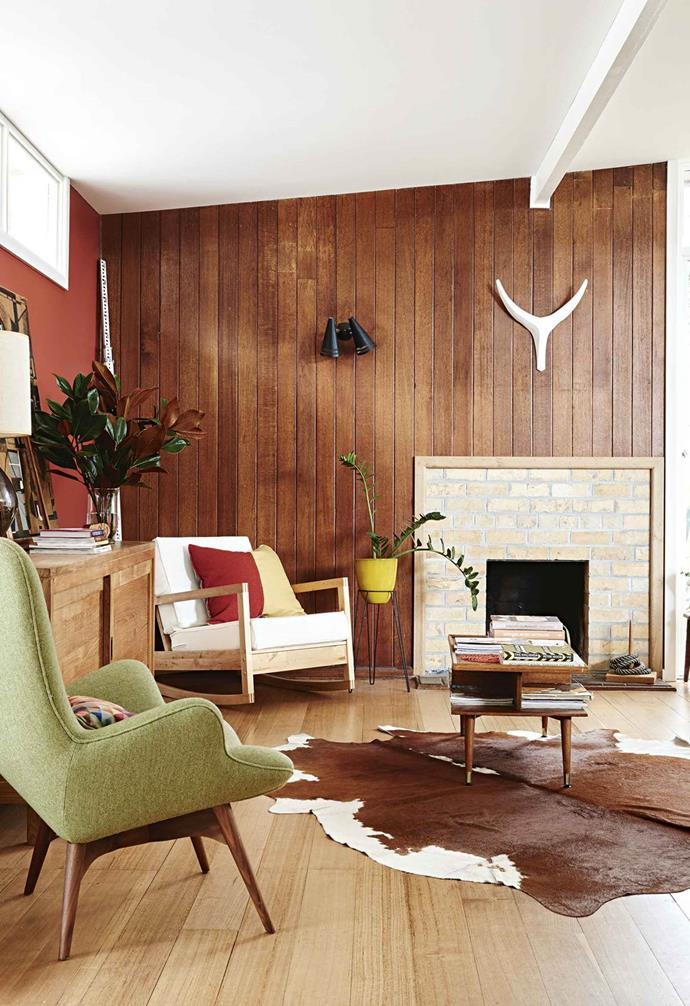 "This [weatherboard house](https://www.homestolove.com.au/retro-mid-century-house-17593|target=""_blank"") was given a retro mid-century modern revamp. An IKEA rocking chair and cowhide rug are a perfect fit for the '60s slatted timber panelling."