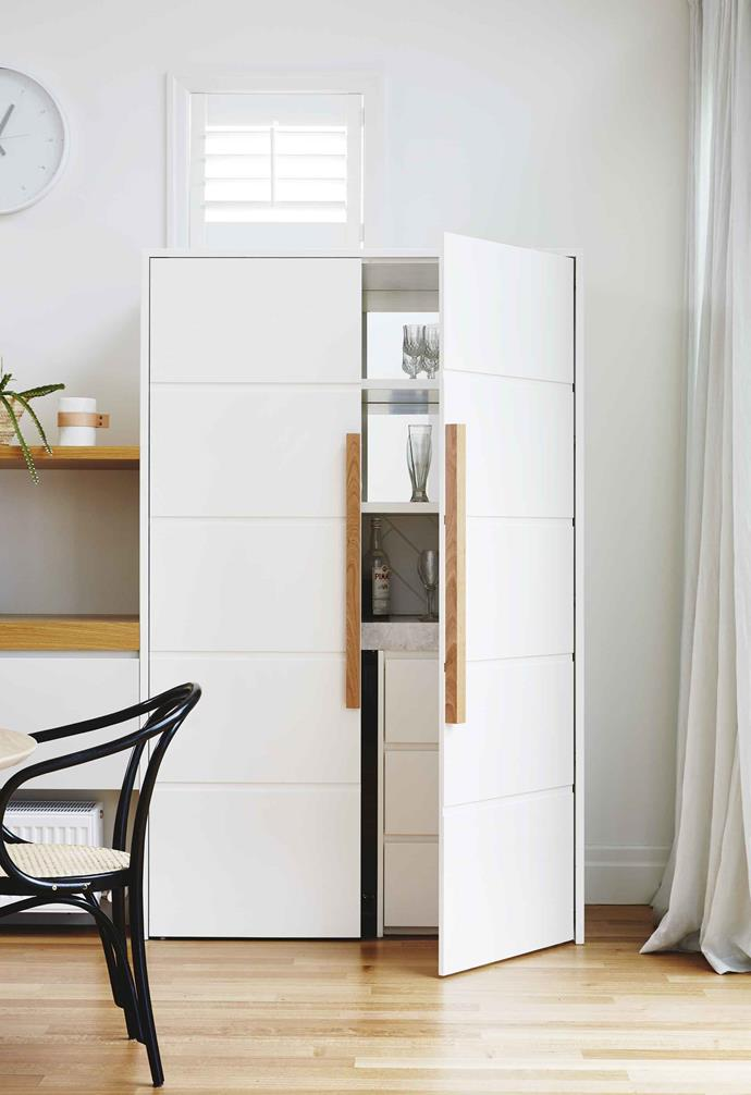 "**Lifting the bar** Bring functionality to a zone with feature joinery. There's a hidden bar area behind the doors of this elegant cabinet, designed by [Bloom Interior Design & Decoration](http://bloominteriordesign.com.au/|target=""_blank""
