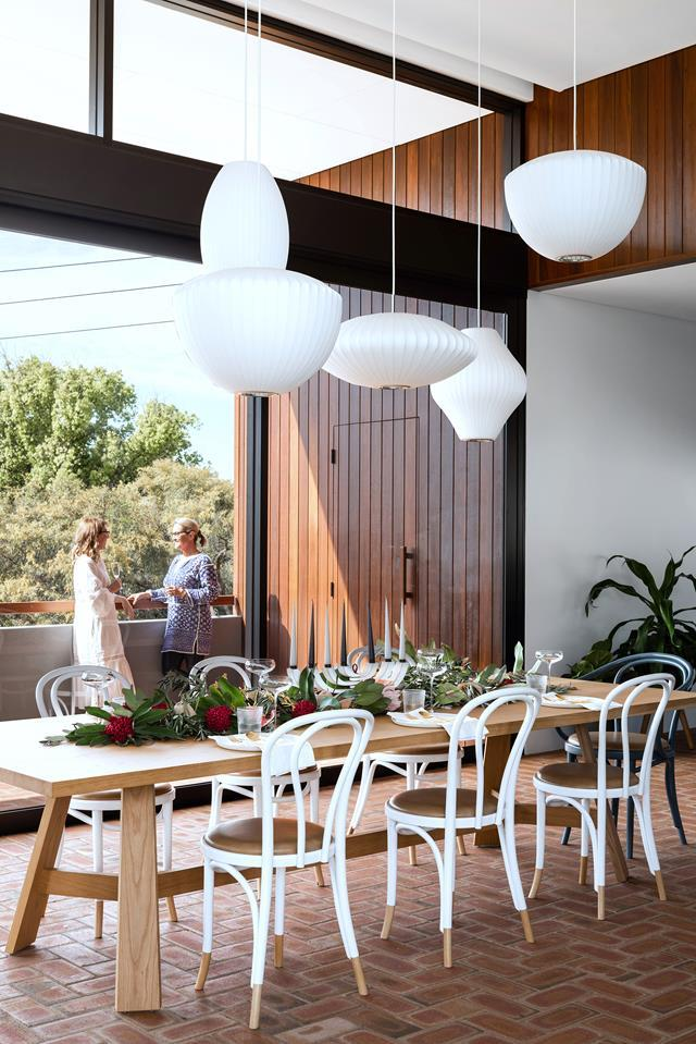 "The owners' of this home wanted beautiful spaces with modern textures and finishes, a sense of open space and the cocooning effect of a private 'compound' in which the family could live and play. The [resulting home](https://www.homestolove.com.au/sloping-corner-block-house-design-19523|target=""_blank"") delivers on all three."