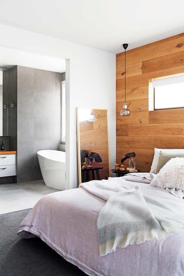 "A feature wall in reclaimed oak deepens the textural interest of this [atmospheric space](https://www.homestolove.com.au/brisbane-workers-cottage-gets-extensive-makeover-2583|target=""_blank"")."
