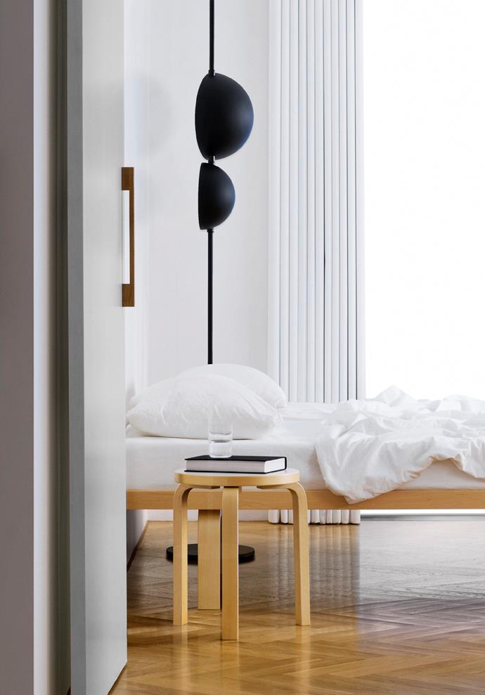 Artek 'Day Bed 710' and 'Stool 60' from Anibou and Oluce 'Superluna 397' floor lamp from Euroluce.