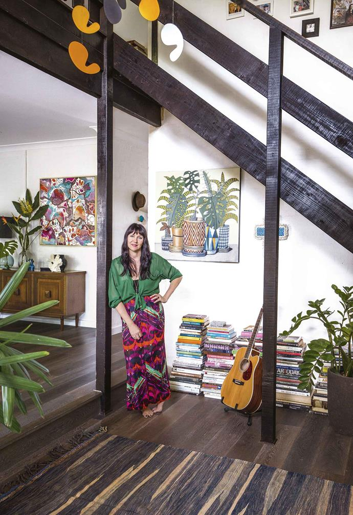 """The family loved their life in cosmopolitan Melbourne, but they were growing out of their tiny Footscray cottage. They drew up plans to extend, but the whole exercise proved too costly. Then the idea of moving to NSW started to feel more tangible.<br><br>**Living area** Homeowner Rosetta stands beneath stairs finished in [Black Japan stain](https://www.homestolove.com.au/timber-stains-the-essential-guide-10122