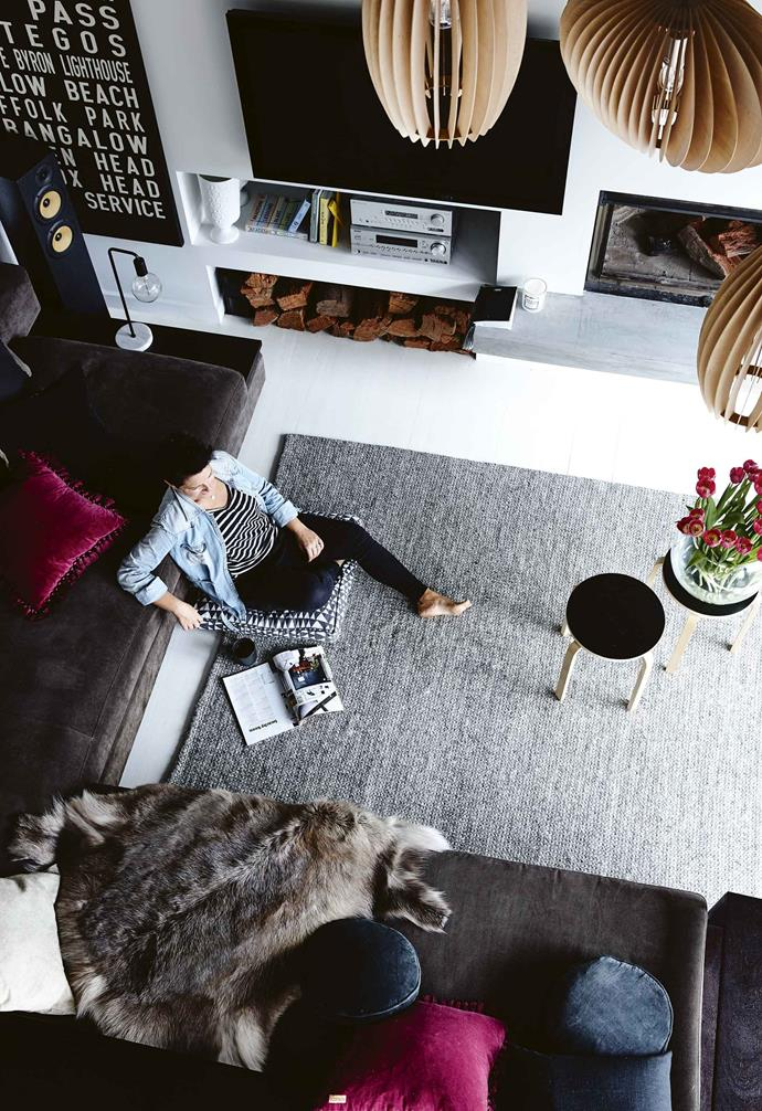 "Despite their passion for the Byron area – the family visit several times each year – a move north wasn't logical for work so, on a whim, Helen searched online for properties closer to 16-year-old Hudson's school in Glen Waverley and struck gold: ""I saw this one and I fell in love instantly.""<br><br>**Living area** In winter, ""the fire's going constantly,"" says Helen of the fireplace from Chazelles Fireplaces. A custom-made bus scroll adds to the relaxed vibe."