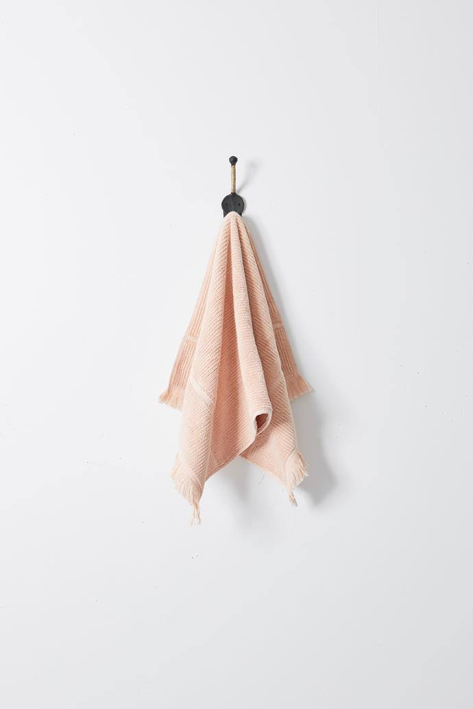 "Luxe Hand Towel in Peach, $26, [The Beach People](https://thebeachpeople.com.au/collections/bath-towels/products/luxe-hand-towel|target=""_blank""