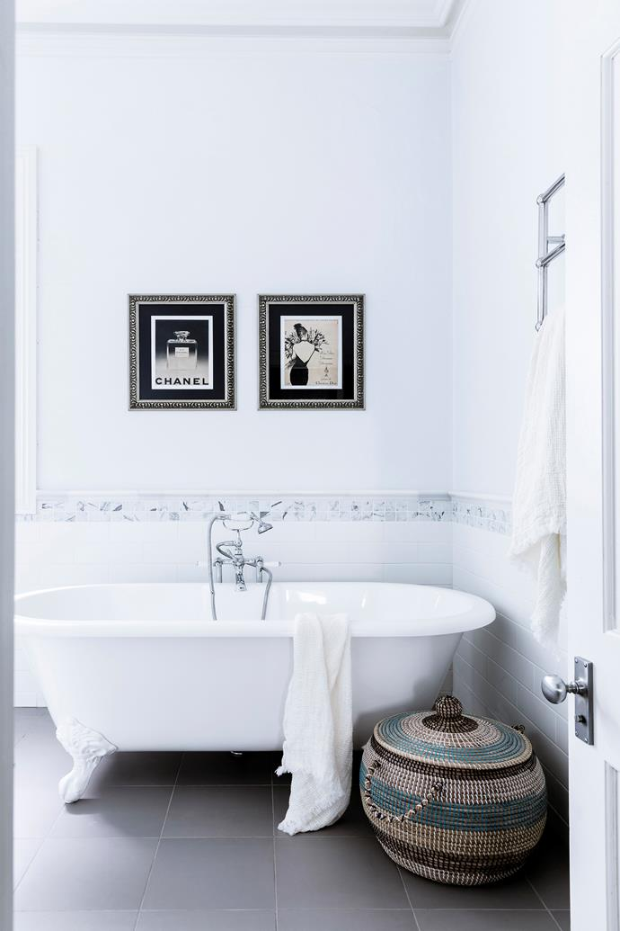 "Transform a purely functional bathroom into a glamorous relaxation zone that you'll never want to leave by displaying eye-catching art and a few decorative items, like baskets (practical and beautiful) and plush towels. A stool or side table topped with a candle and some [attractive toiletries](https://www.homestolove.com.au/bathroom-countertop-accessories-20459|target=""_blank"") would also look right at home here."