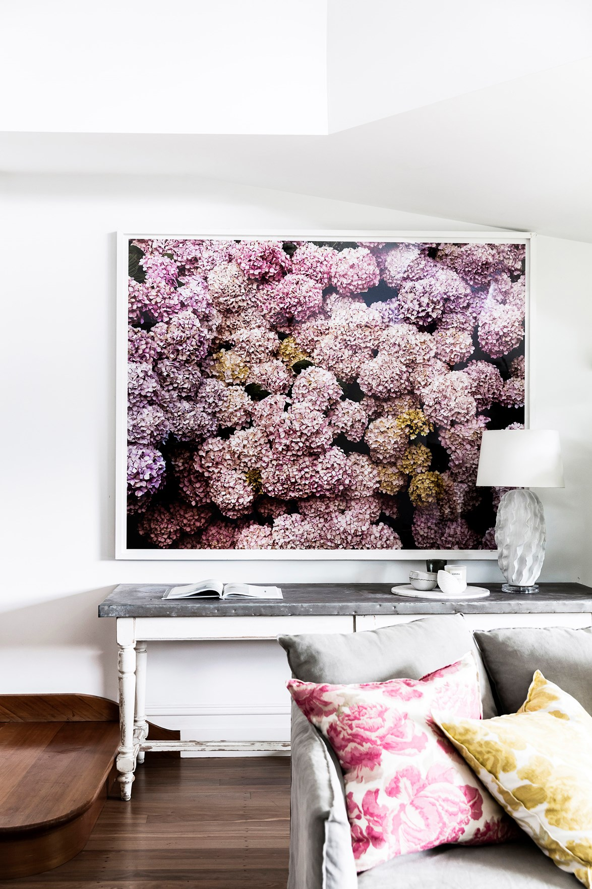 "In [Georgie Abay's beautiful home](https://www.homestolove.com.au/georgie-abay-house-20463|target=""_blank"") this graphic digital print of hydrangeas brings colour and wow factor to an otherwise neutral room, and almost passes as wallpaper."