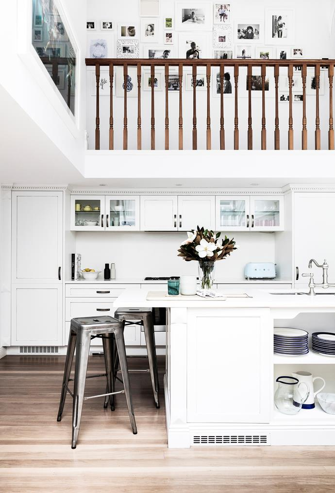 An all-white palette is subtly accented with hints of blue and green for a look that's light and breezy. Bar stools are ideal for casual at-the-counter breakfasts.