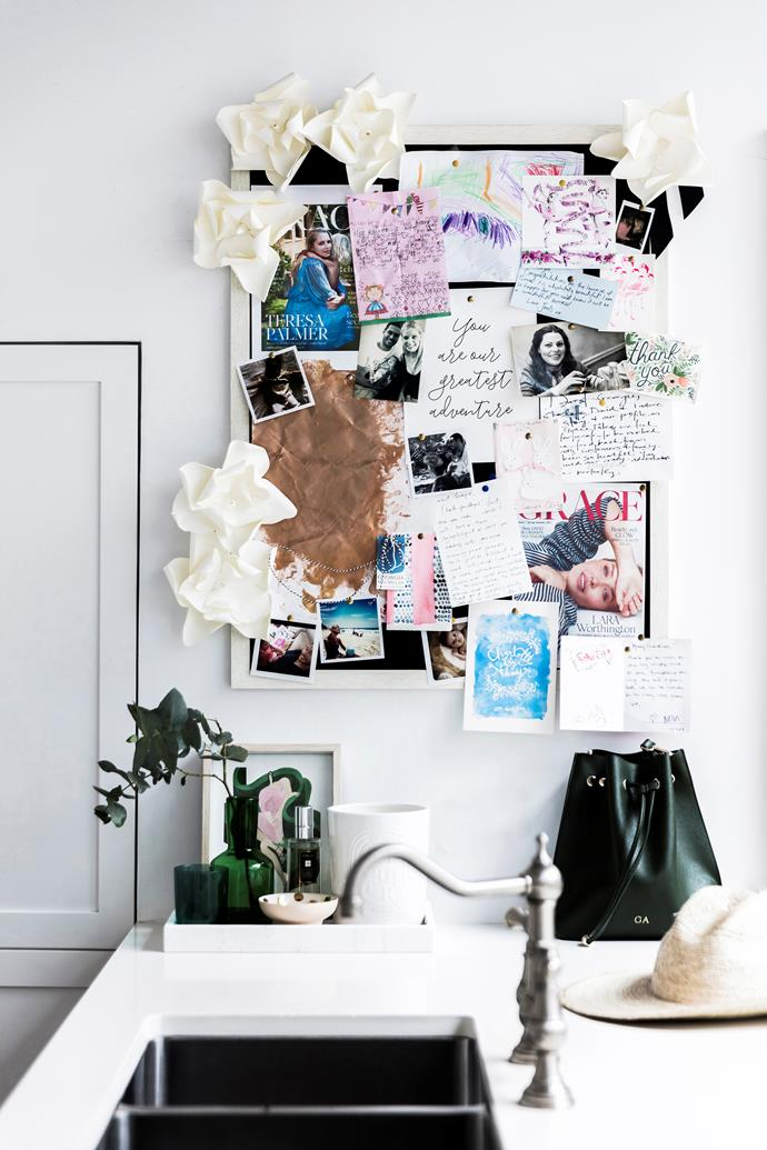 A pinboard provides visual inspiration and keeps the kitchen bench free of loose paper clutter.
