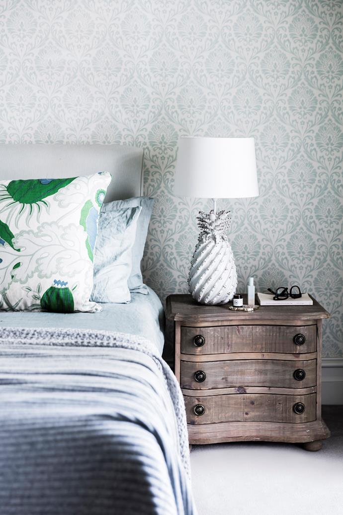 "This cool and calm bedroom is proof that wallpaper doesn't need  to be OTT to make an impact. Go for a subtle design, such as this pretty leafy pattern in silvery blue, then carry the theme into your soft furnishings to create a resolved look. Not ready to commit? There are plenty of [removable wallpaper](https://www.homestolove.com.au/diy-removable-wallpaper-7041|target=""_blank"") options on the market."