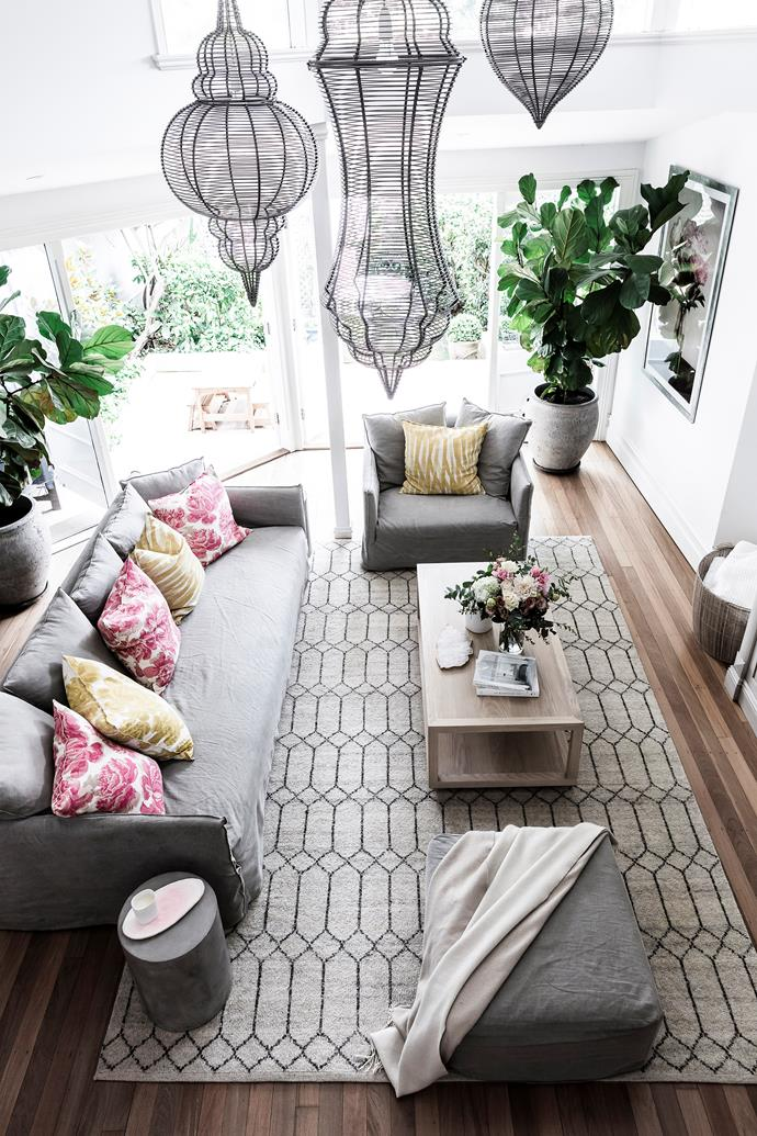 "An oversized [fiddle leaf fig](https://www.homestolove.com.au/tips-for-caring-for-fiddle-leaf-fig-trees-4923|target=""_blank"") doubles as a sculptural piece and connects the indoors with the garden."