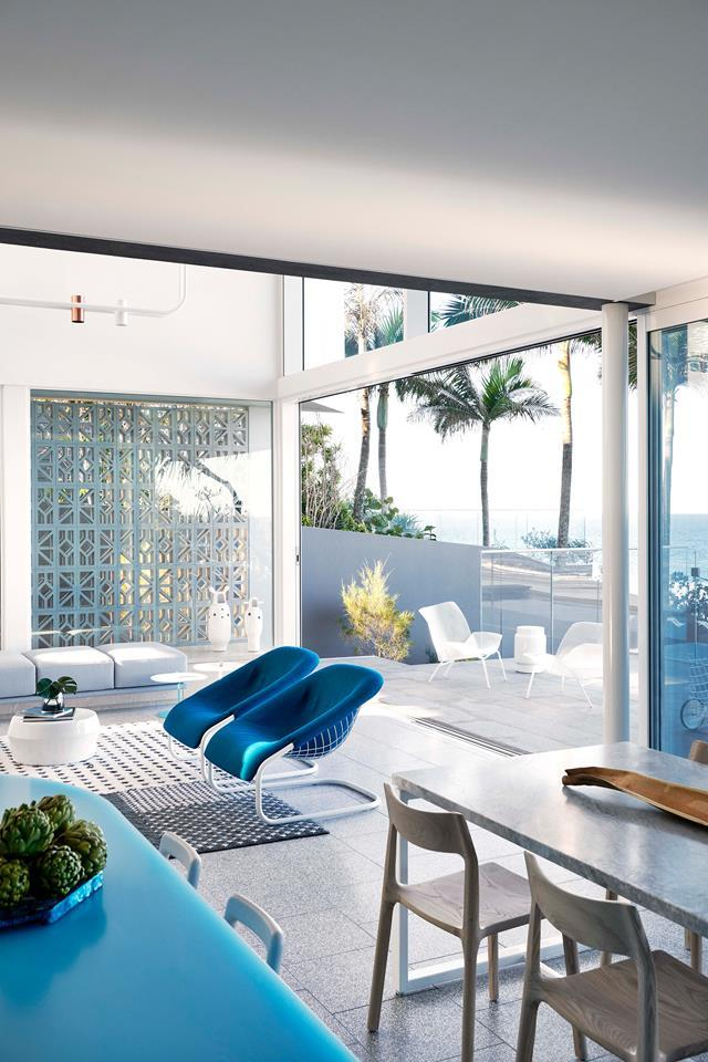 "Whispers of Palm Springs, a marine palette and an oceanic outlook make for a [breezy beach retreat](https://www.homestolove.com.au/palm-springs-style-beach-house-19258|target=""_blank"").The light-filled living room is an extension of the outdoors. A breeze block wall filters soft light to the interiors. Design by PopovBass Architects. From *Belle* November 2018."