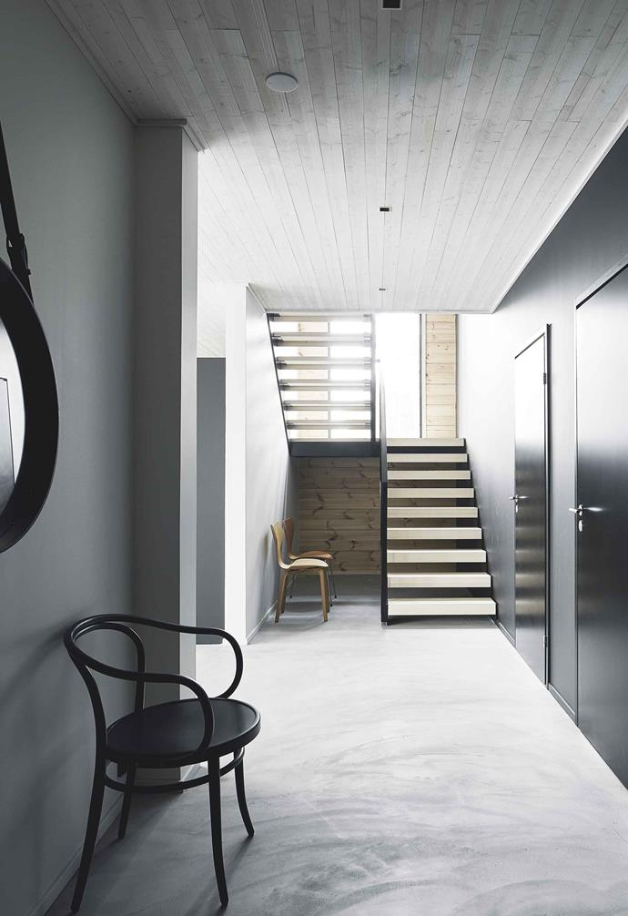 **Hallway** The graphic steel staircase by Grado draws the eye across the sweeping strokes of the micro-concrete floor.