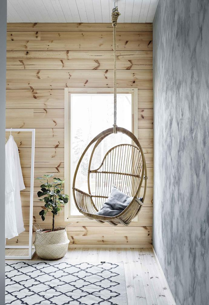 **Guest bedroom** This space has a restorative feel and the best views of the lake. The swinging chair is by Parolan Rottinki.