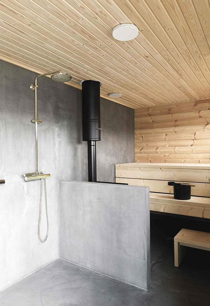 **Sauna** This classic steam room on the ground floor combines Honka Ink's signature materials: wood, concrete and matt-black detailing.