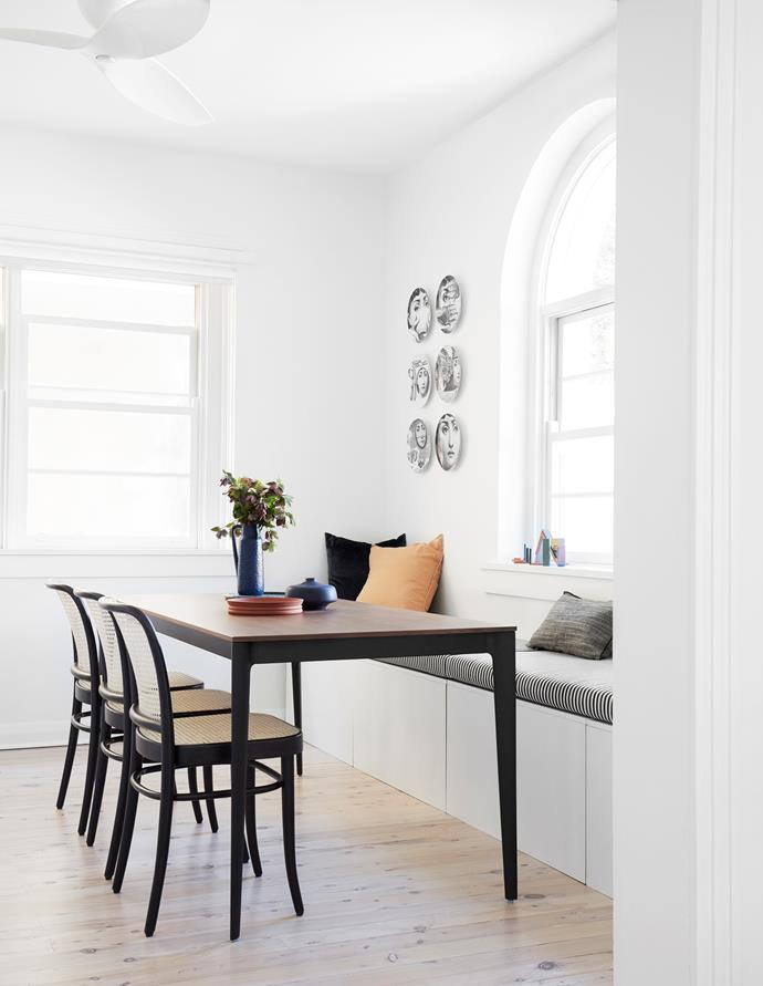 The 'Tarino' dining table from BoConcept doubles as a workspace, paried with Ton 'Chair 811' chairs from James Richardson. Jug and vase from Fred International, 'Tezza' bowl from Jardan and large linen cushions from Design Twins.