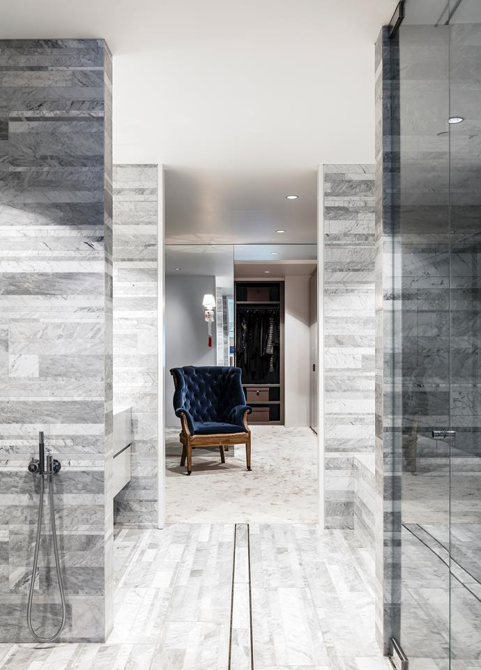 A soft-grey palette features in the bathroom with Salvatori Carrara marble tiles from Boffi and Vola tapware from Candana.